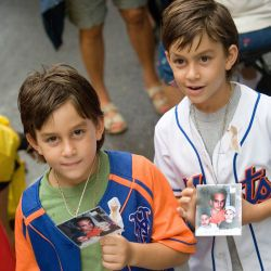 [Terrorist Attack] New York, NY, September 11, 2007 -- Ground Zero - Johnathon and Eric Sparacio, eight-year-old twins, show a photo of their father holding them when they were two years old. The are