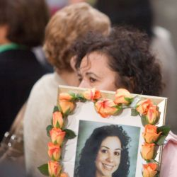 [Terrorist Attack] Ground Zero, NY, September 11, 2007 -- Mother carries an image of her daughter during 9-11 Memorial Service at Ground Zero. Andrea Booher/FEMA