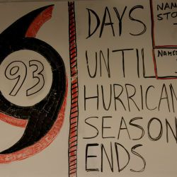 [Hurricane Katrina] New Orleans, LA, August 26, 2008 -- FEMA employees here at the Louisiana TRO make a white board sign tracking how many more days until hurricane season is over and how many hurrica