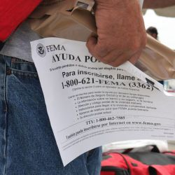 [Hurricane Gustav] Baton Rouge, LA, September 6, 2008 -- Re-entree Evacuee holds an MRE and a filer about registering with FEMA outside the Elmwood Park. Jacinta Quesada/FEMA