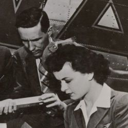 A Crate of Lettuce Gets First Class Attention from a Pilot, Flight Attendant, and an Unidentified Man Before Flying to the East Coast