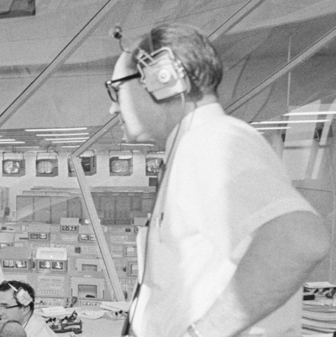 Photograph of Apollo Program Director Lieutenant General Samuel C. Phillips Monitoring Pre-launch Activities