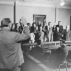 "Photograph of County Clerk ""Bun"" Towner Swearing-in a Trial Jury in the Court House"