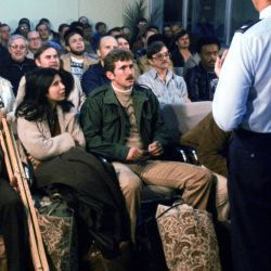 Evacuees from the US Embassy in Tehran, Iran, are briefed upon their arrival at the air base terminal.