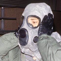 AIRMAN test biological-chemical warfare gear during a training exercise