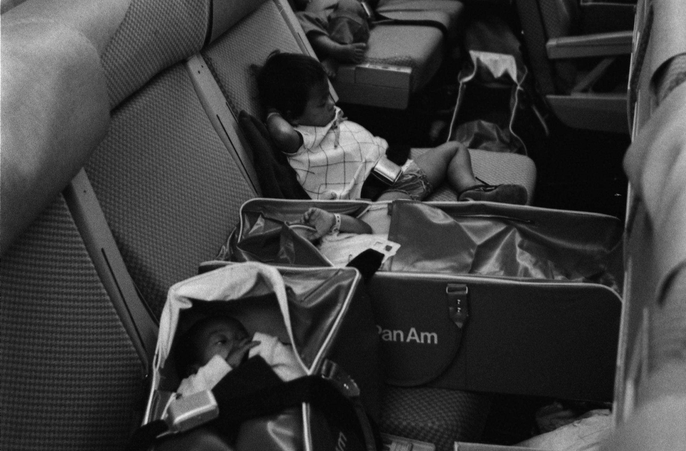 Vietnamese Refugee Children on a Flight to San Francisco