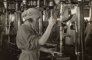 Woman Operating a Drill Press