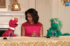 First Lady Michelle Obama with Sesame Street Muppets Elmo and Rosita