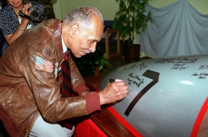 Dr. Roscoe C. Brown, Jr., Signs a Fighter Plane