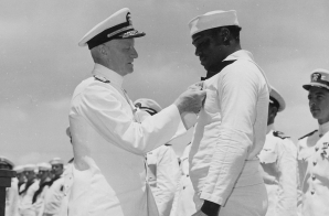 Admiral C. W. Nimitz, CinCPac, pins Navy Cross on Doris Miller, at ceremony on board warship in Pearl Harbor, T. H.