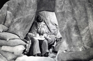 Private Writing a Letter in Normandy