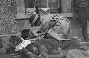Mrs Hammond, American Red Cross, serving water to wounded British Soldier
