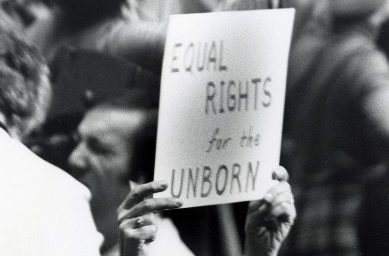 Woman Holding Equal Rights for the Unborn Poster