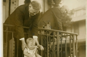 Herbert Hoover Greets a Child as He Returns to California