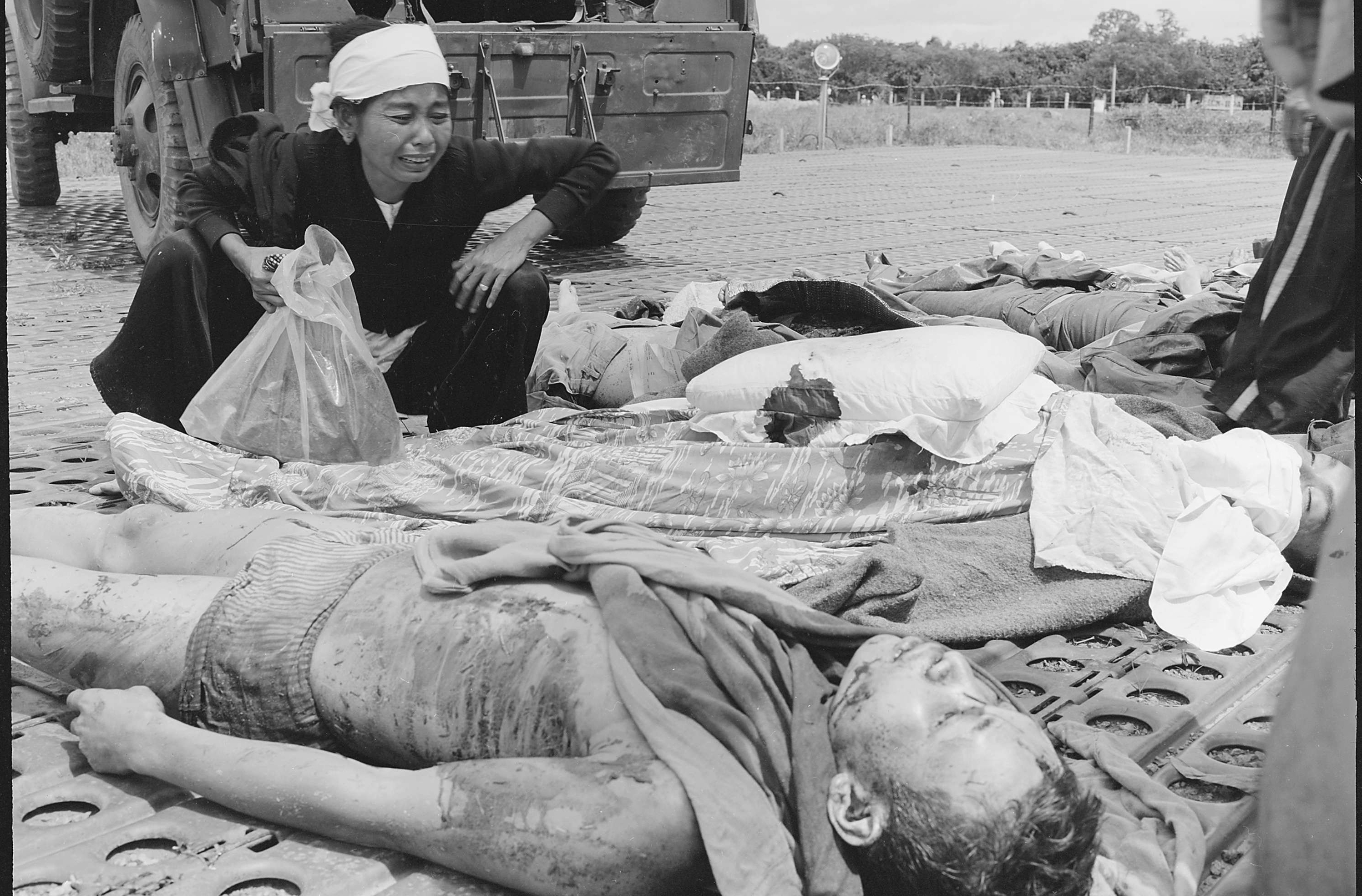 A Vietnamese Woman Weeps Over the Body of Her Husband