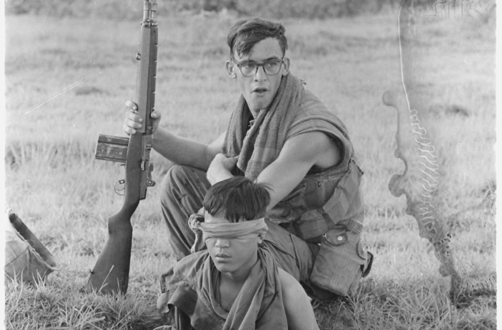 Corporal Carter Guards an NVA Soldier he Captured