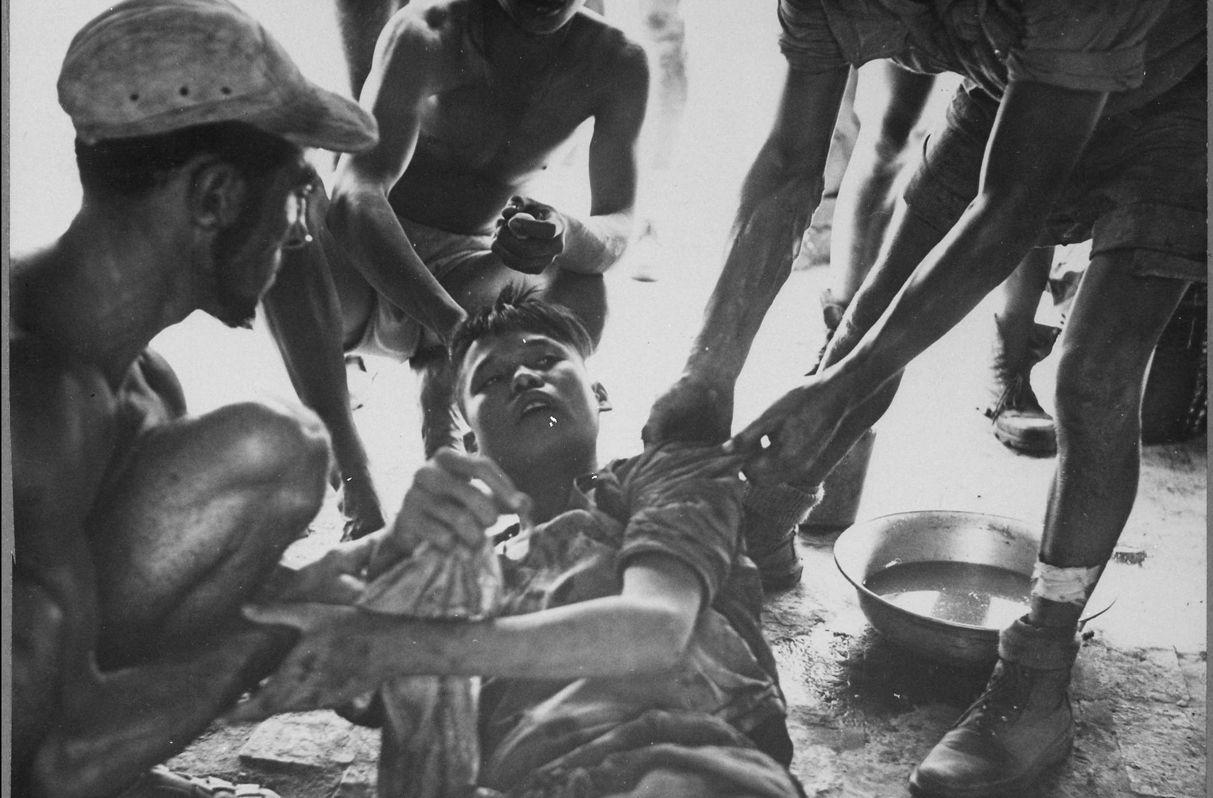 Wounded Vietminh Prisoner is Given First Aid