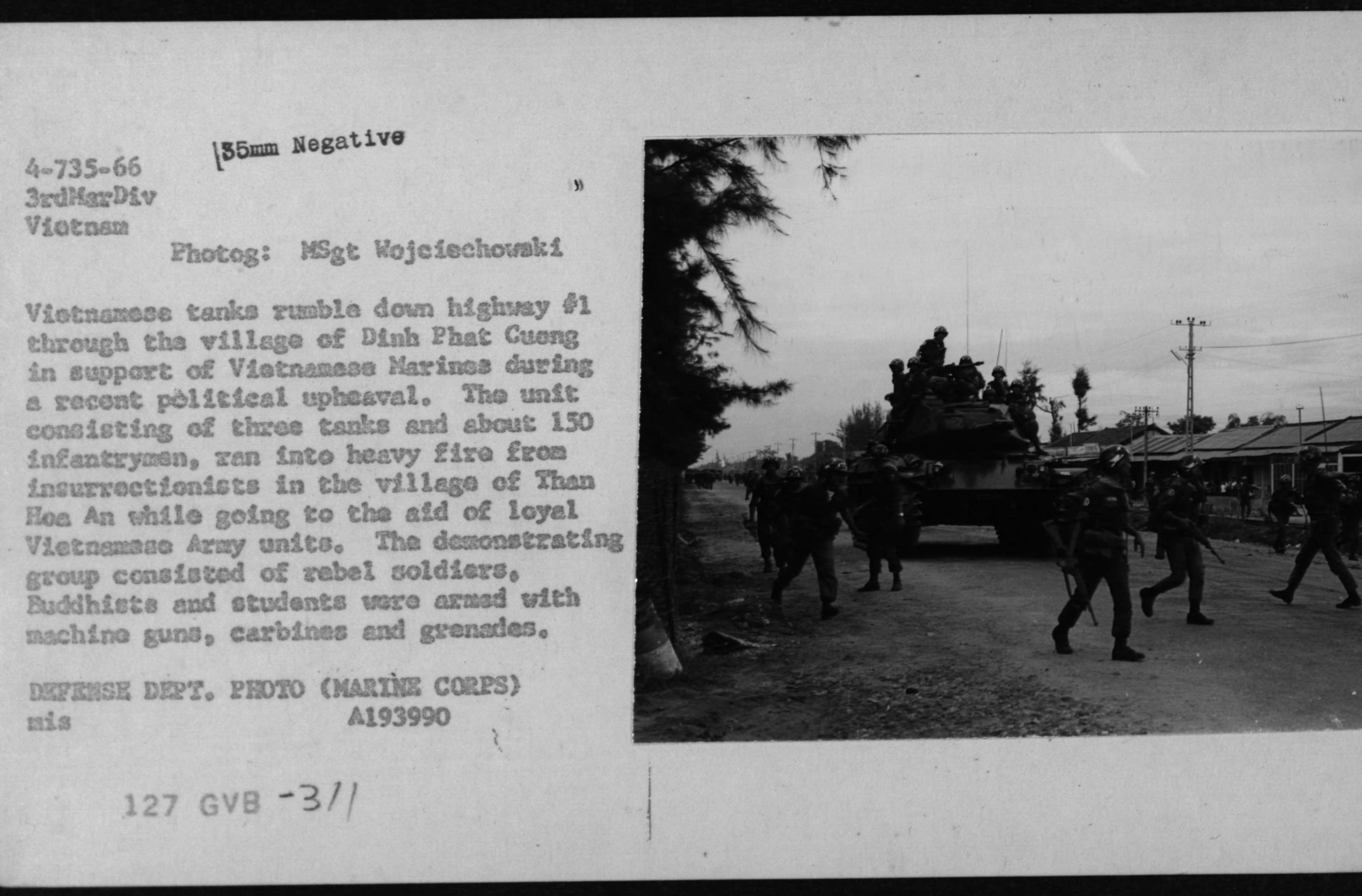 Vietnamese Tanks Rumble Through the Village of Dinh Phat Cuong