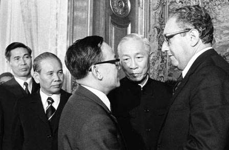 Henry A. Kissinger and Le Duc Tho Shake Hands After Initiating the Vietnam Peace Agreement
