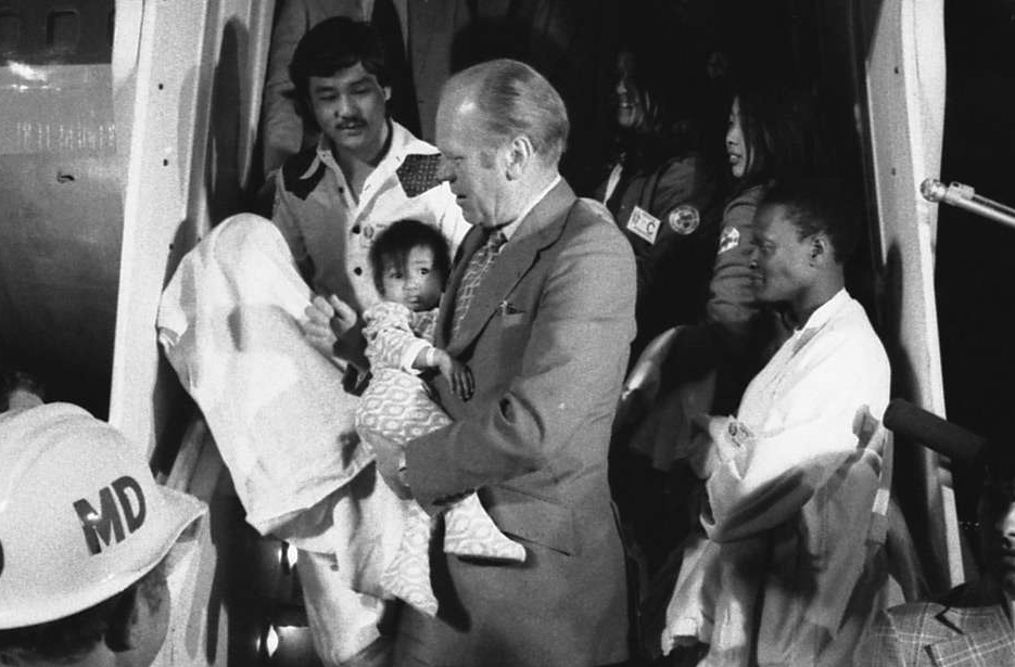 "President Gerald R. Ford Carrying a Vietnamese Baby from ""Clipper 1742"""